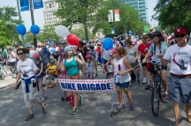 """The """"Bike Brigade"""" joins the 26th annual 4th on 53rd Parade as it kicks off on South Lake Park Avenue, Tuesday, July 4, 2017."""