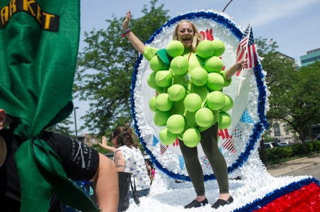 A Hyde Park Produce employee enjoys herself during the 26th annual 4th on 53rd Parade as it moves south on South Lake Park Avenue, Tuesday, July 4, 2017.