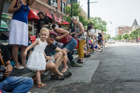 A young girl looks east on 53rd Street toward the the 26th annual 4th on 53rd Parade as it moves west through the 53rd Street Canadian National viaduct, Tuesday, July 4, 2017.