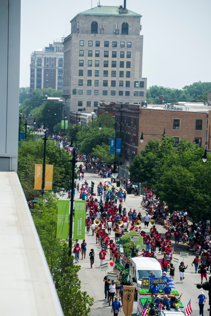A view of the 26th annual 4th on 53rd Parade looking east as the parade moves west along 53rd Street from the 4th floor terrace of the Vue53 building, 1330 E. 53rd St., Tuesday, July 4, 2017.