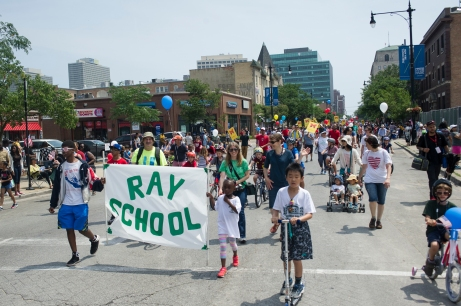 Ray School representatives march west down East 53rd Street during the 26th annual 4th on 53rd Parade, Tuesday, July 4, 2017.