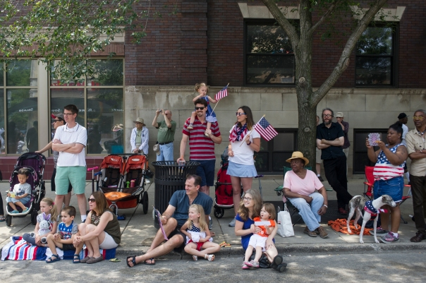 Spectators enjoy the 26th annual 4th on 53rd Parade as it moves west down East 53rd Street, Tuesday, July 4, 2017.