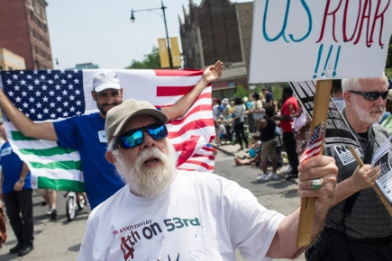 Jay Mulberry marches with other Hyde Park residents protesting the Trump administration during the 26th annual 4th on 53rd Parade, Tuesday, July 4, 2017.