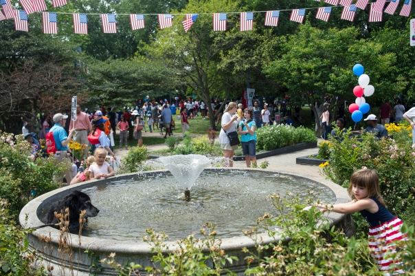 The fountain in Nichols Park serve as a cooling station after the 26th annual 4th on 53rd Parade, Tuesday, July 4, 2017.