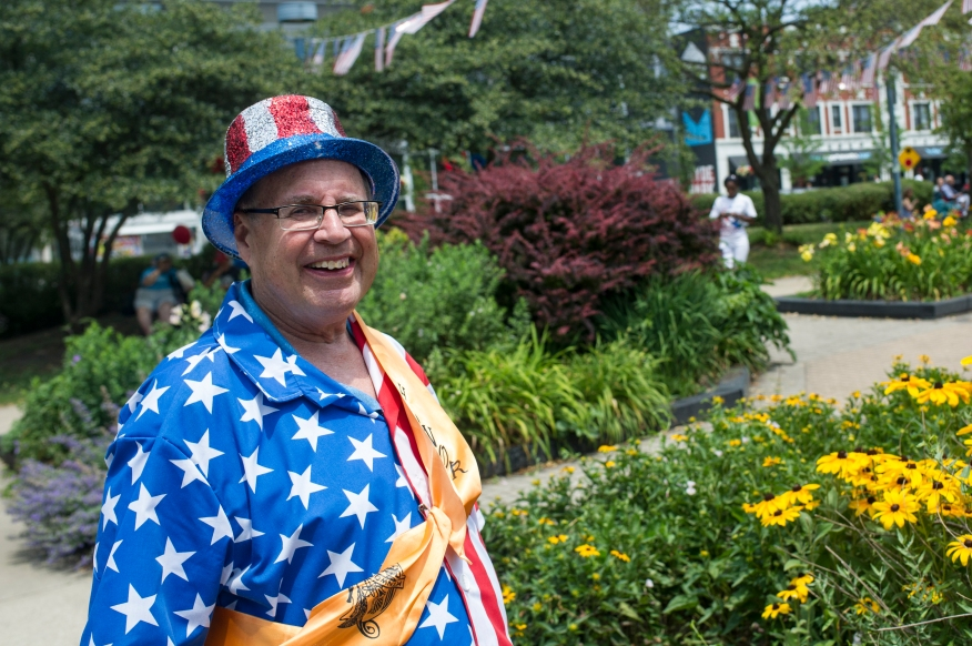 Parade Grand Marshal Gary Ossewaaade poses for the camera in Nichols Park following the 26th annual 4th on 53rd Parade, Tuesday, July 4, 2017.