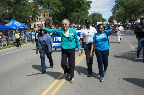 Cook County Board President Toni Preckwinkle and Circuit Court Judge H. Yvonne Coleman wave as they march during the 88th annual Bud Billiken Parade, Saturday, August 12, 2017.