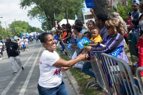 Fourth Ward Alderman Sophia King greets people watching the 88th annual Bud Billiken Parade, Saturday, August 12, 2017.