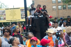 A group of young people enjoy the 88th annual Bud Billiken Parade, Saturday, August 12, 2017.