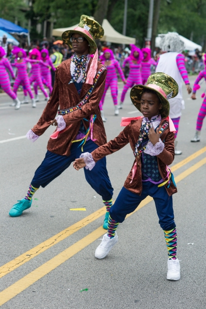 "Dancers in ""Alice in Wonderland"" themed costumes perform during the 88th annual Bud Billiken Parade, Saturday, August 12, 2017."