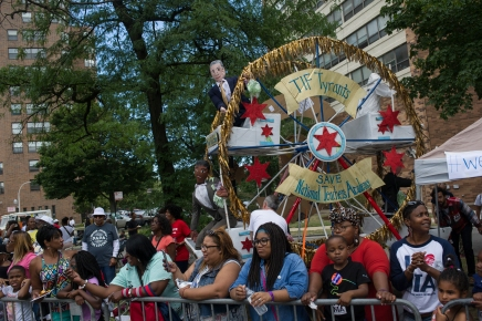 "Teachers and parents from the South Loop's National Teachers Academy display a Ferris Wheel ""float"" protesting the proposed closing of the school during the 88th annual Bud Billiken Parade, Saturday, August 12, 2017."