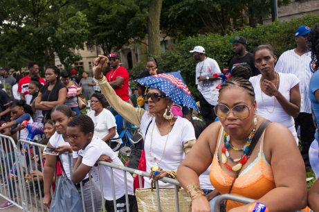 Parade watchers enjoy the temperate weather and the 88th annual Bud Billiken Parade, Saturday, August 12, 2017.
