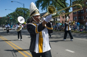 The Martin Luther King College Preparatory High School Marching Jaguars perform during the 88th annual Bud Billiken Parade, Saturday, August 12, 2017.