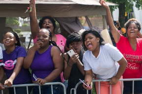 "A group of girls reacts as parade Grand Marshal Chance the Rapper signs a ""3"" in their direction during the 88th annual Bud Billiken Parade, Saturday, August 12, 2017."