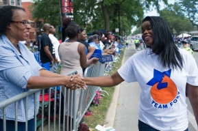Cook County State's Attorney Kim Foxx greets parade watchers during the 88th annual Bud Billiken Parade, Saturday, August 12, 2017.