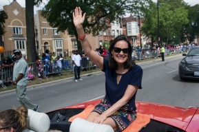 Illinois Attorney General Lisa Madigan waves at parade goers during the 88th annual Bud Billiken Parade, Saturday, August 12, 2017.