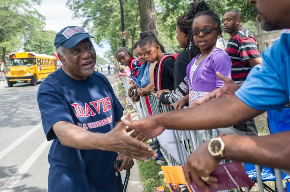 Congressman Danny Davis greets parade watchers during the 88th annual Bud Billiken Parade, Saturday, August 12, 2017.