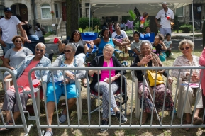 Parade watchers enjoy the 88th annual Bud Billiken Parade, Saturday, August 12, 2017.