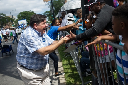 Gubernatorial candidate J.B. Pritzker greets parade watchers during the 88th annual Bud Billiken Parade, Saturday, August 12, 2017.