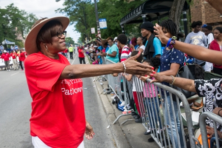 Third Ward Alderman Pat Dowell greets parade watchers during the 88th annual Bud Billiken Parade, Saturday, August 12, 2017.